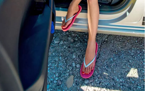 Is it illegal to drive barefoot or while wearing flip flops?